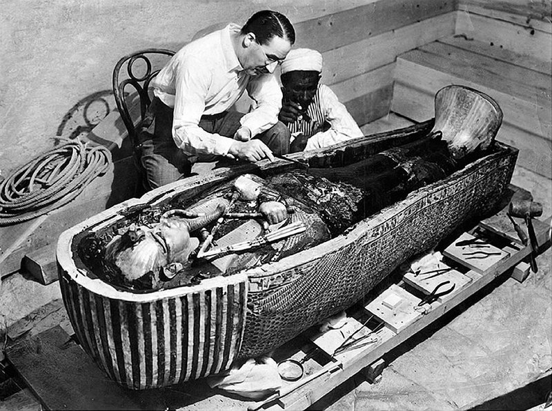 Howard Carter inspects Tutankhamun's mummy, 1922.  The New York Times. Public Domain.